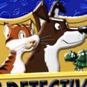 illustration of Dozens of pets have been lost! Race against other pet detectives to locate them. Find the most pets and you win the game! Final package was released both in a box and in a tin box as shown here.